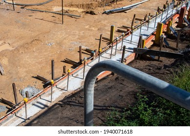 Gosford, NSW, Australia - December 6, 2020: Building progress new 40 units under construction at 56-58 Beane. St. Excavation and foundation work on site. Part of a series for commercial use.