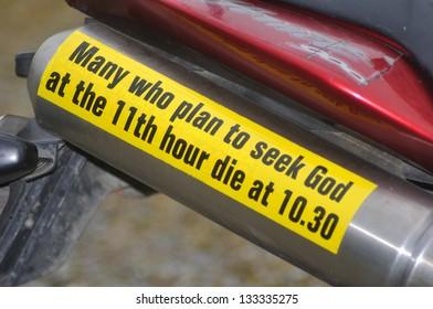 Gospel bumper sticker on a motorbike