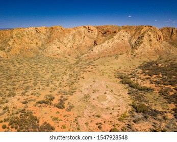 Gosses Bluff is thought to be the eroded remnant of an impact crater. Known as Tnorala to the Western Arrente people, it is located in the Northern Territory, near the centre of Australia