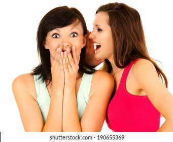 gossip, young woman whispering to the friends ear, white background