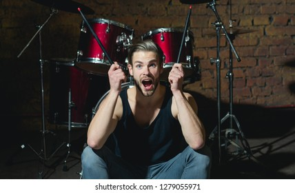 I got the beat. Rock star or rocker. Excited man sit on stage at percussion instrument. Man drummer with musical instrument. Rock concert or rehearsal in music club. Enjoying instrumental music.