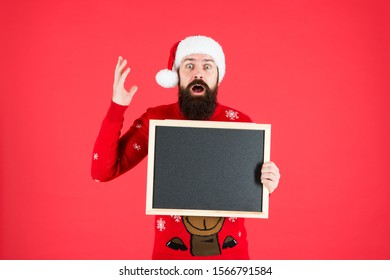Got gift idea. Santa hold empty blackboard for wish list idea. New Year eve idea. Christmas party. Holiday celebration. Place for your idea, copy space.