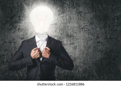 Got an idea! Businessman with light bulb instead head. Concepts of creativity, thinking, finding solutions and power of human brain.