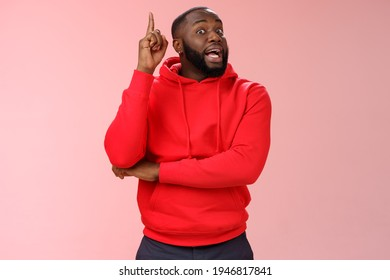 Got idea. Portrait excited african-american bearded guy inhale air have speech reise index finger eureka gesture wanna add word, have excellent plan sharing thoughts, standing pink background - Shutterstock ID 1946817841