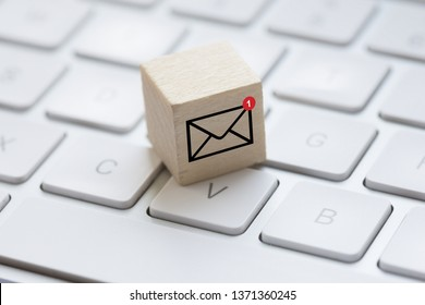 You've got mail message concept with computer keyboard and e-mail box suggesting inbox received