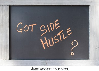 Got Side Hustle Sign handwritten on black board with wood frame for concept of Entrepreneurship