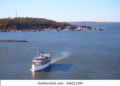 Gota River in the archipelago of Gothenburg, Sweden, Scandinavia with boat and houses along the shore