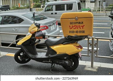 GOTANDA, TOKYO - AUGUST 23, 2014: Sokuhai express delivery motorbike. Motorcycle courier service is popular for business use in Japan, especially in Tokyo. Sokuhai is one of the biggest transporter.