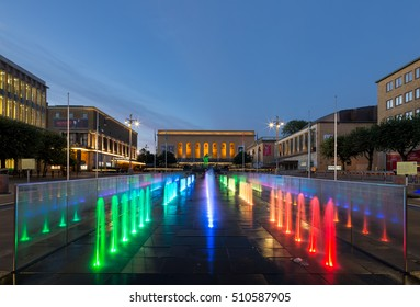 Goteborg, Sweden - Aug 12, 2016: Gotaplatsen, located at the top of the avenue with theatre, Concert hall and museum of art. New colorful illuminated fountain in street in front of the poseidon statue