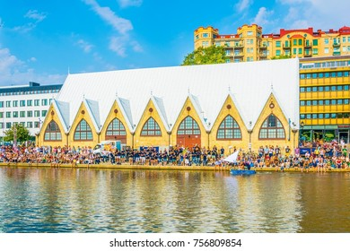 GOTEBORG, SWEDEN, AUGUST 25, 2016: Young people are having fun in front of the feskekorka fish market in Goteborg, Sweden.