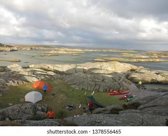 Gothenburg Archipelago / Sweden July 2018: Kayak camp in sunset - Gothenburg Archipelago Sweden