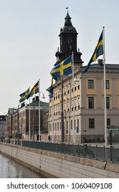 Gothenburg City Hall with row of Swedish flags