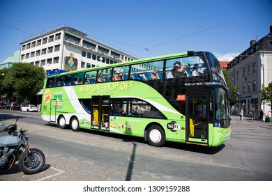 Gothenburg, Sweden - 07/19/2017: Tourists on sighseeing in a Hop on - hop off bus.