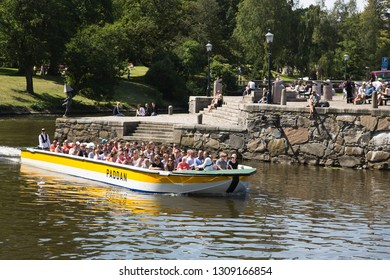Gothenburg, Sweden - 07/19/2017: Tourists on a sightseeing tour with famous Paddan, Gothenburg.