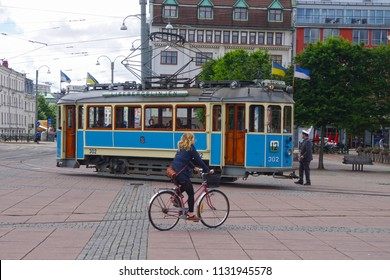 Gothenburg, Sweden - 21 April 2018 - Historic blue tramway through the streets of Gothenburg city.