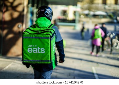 Gothenburg, Sweden - April 11, 2019: Uber eats delivery person carrying food to people who order by online app