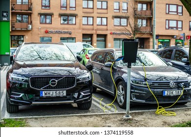Gothenburg, Sweden - April 6, 2019: Volvo S90 and VW Passat new generation Hybrid electric Vehicle charging on the Goteborg Street Car Park