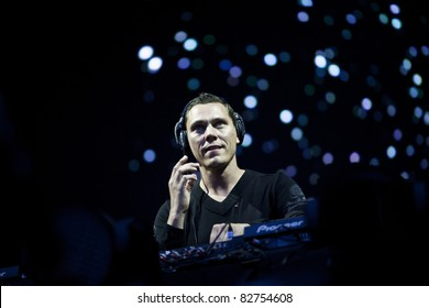 GOTHENBURG, SWEDEN - AUGUST 13: Tiësto performs a live DJ set at the Way Out West festival on August 13, 2011 in Gothenburg, Sweden. His show featured flames, fireworks and confetti.