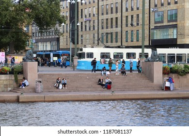 GOTHENBURG, SWEDEN - AUGUST 26, 2018: Blue tram and bus in Gothenburg, Sweden. Gothenburg has largest tram network in Sweden with 160 km of single track.