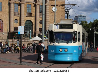 GOTHENBURG, SWEDEN - AUGUST 26, 2018: People board blue tram in Gothenburg, Sweden. Gothenburg has largest tram network in Sweden with 160 km of single track.