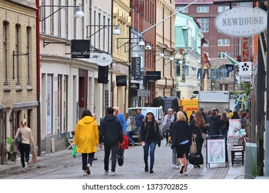 GOTHENBURG, SWEDEN - AUGUST 27, 2018: People shop at Vallgatan street in Gothenburg, Sweden. Gothenburg is the 2nd largest city in Sweden with 1 million inhabitants in the metropolitan area.