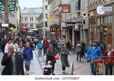 GOTHENBURG, SWEDEN - AUGUST 27, 2018: People shop at Kungsgatan street in Gothenburg, Sweden. Gothenburg is the 2nd largest city in Sweden with 1 million inhabitants in the metropolitan area.