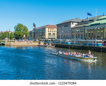 """Gothenburg - Sweden. Circa June, 2018:  Trams busses and sightseeing boat is passing along the street named """" Södra Hamngatan""""."""