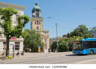 "Gothenburg - Sweden. Circa June, 2018:  Local bus is driving along the central street named ""Norra Hamngatan"". The chathedral in the background is named ""Domkyrkan""."