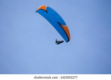 Gothenburg - Sweden. Circa June, 2019: Man is hand gliding in the outskirts of city.