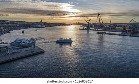 """Gothenburg - Sweden. Circa Mars, 2019: Busy station named """"Stenpiren"""" in the foreground and harbour and cityscape in the background."""