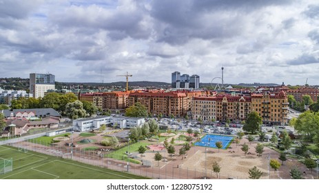"Gothenburg - Sweden. Circa October, 2018: An image of a busy area with sport activities named ""Heden"" in the foreground and Gothenburg cityscape in the background."