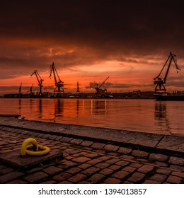 Gothenburg, Sweden - February 27 2015: Cranes of and old wharf in a beautiful sunset.