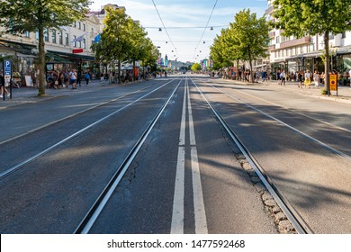 GOTHENBURG, SWEDEN - JULY 17, 2019: Perspecktive city street view of main street Avenyn with tram rails  and incidental people in Gothenburg Sweden July 17, 2019.