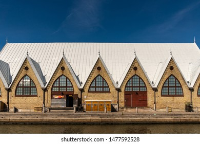 GOTHENBURG, SWEDEN - JULY 17, 2019: Front facade sea view of the church like famous historic Feskekorka fish market building by the water in Gothenburg Sweden July 17, 2019.