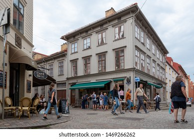 Gothenburg, Sweden - July 19, 2019: View of cafes and pedestrians in the famous district of Haga in Gothenburg, Sweden.