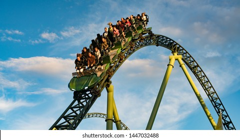 GOTHENBURG, SWEDEN - JULY 8, 2019: People screaming and holding up hands during roller coaster ride Helix at Liseberg amusement park Gothenburg Sweden - People having fun at their leisure.