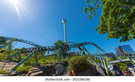Gothenburg, Sweden - June 15 2014: Lisebergstornet and the Helix rollercoaster at Liseberg
