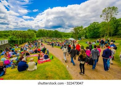 GOTHENBURG, SWEDEN - JUNE 19, 2015: Visitors celebrating traditional Midsummer celebration in Gunnebo Castle