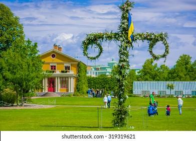 GOTHENBURG, SWEDEN - JUNE 21, 20015: Midsummer cross in Tradgardsforeningen, the Garden Society park, Gothenburg city downtown