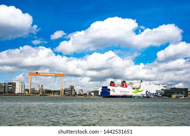 GOTHENBURG, SWEDEN - JUNE 30, 2019: Scenery of Stena line Ship and the trendy District Eriksberg and Eriksbergs Crane (a memory of the past) in Gothenburg Sweden.
