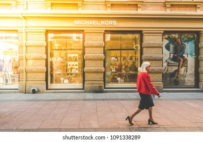 Gothenburg, Sweden - May 02, 2018:  an Elderly Woman Walking by a Michael Kors Store in Central Gothenburg