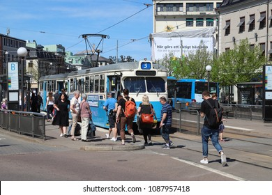GOTHENBURG, SWEDEN - MAY 8, 2018: People at the tram stop on Kungsportsplatsen in Gothenburg city centre, Sweden