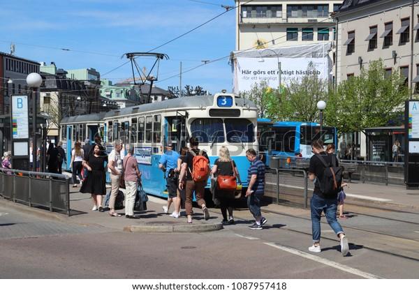 GOTHENBURG, SWEDEN - MAY 8, 2018: People at the tram stop on Kungsportsplatsen in Gothenburg city centre, Sweden