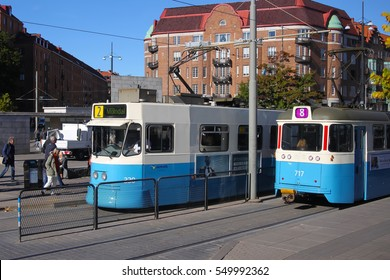 Gothenburg, Sweden - Oct. 4. 2016: Transit streetcars at a main street stop in Gothenburg, Sweden, Scandinavia