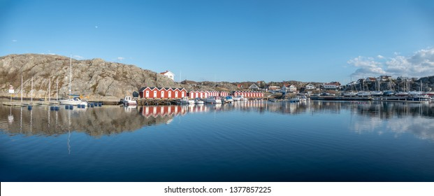 Gothenburg, Sweden-April 16, 2019: Panorama of  sandvik guest harbour  on styrso island in the gothenburg archipelago, with boats and red cabin visible
