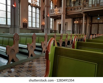 Gothenburg,Sweden-Circa September 2018: The interior of Oscar Fredrik's Church beautifully presents in lush greenish colors especially pews in rows facing east to the choir stage.
