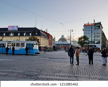 Gothenburg,Sweden-Circa September 2018: Several people wait for tram to travelling around downtown during sunset by the beginning autumn season.