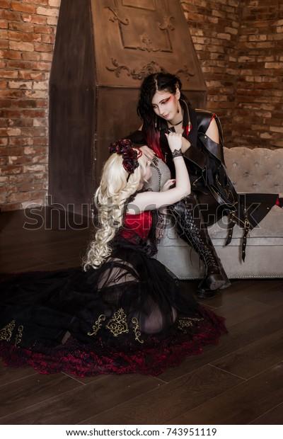Gothic Aristocrat Vampire Holds Womans Hand Stock Photo