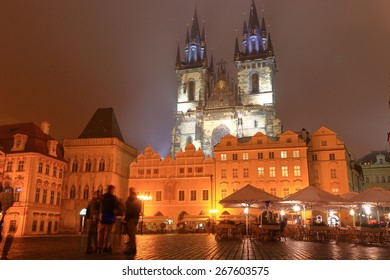 Gothic building of the Church of Our Lady before Tyn visible from the main square of Prague old town in foggy night, Czech Republic