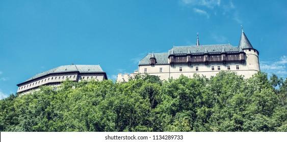 Gothic castle Karlstejn in Czech republic. Ancient architecture. Travel destination. Side view. Blue photo filter.